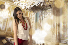 Beauty mystical face woman, luxurious interior background stock photo