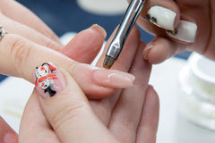 Beauty nails construction Royalty Free Stock Photo