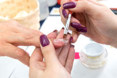 Beauty nails construction whit gel Stock Photo