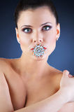Beauty naked girl and her brooch Royalty Free Stock Photos