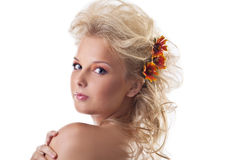 Beauty naked woman portrait with flower blond hair Royalty Free Stock Photography