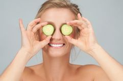 Beauty - the natural way. Facial mask with cucumber. royalty free stock photos