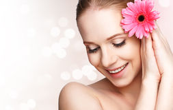Beauty natural  young girl with flower pink gerbera Stock Photography