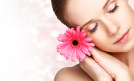 Beauty natural  young girl with flower pink gerbera Royalty Free Stock Photo