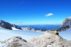 Beauty of nature, amazing alpine landscape with rocks, walking in mount, blue sky, clouds, snow, sun stock image