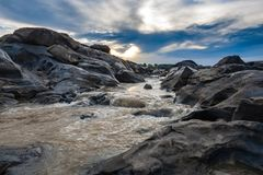 Stream flowing in mekong river, Thailand. Beauty nature with brown river at sunset Stock Photo