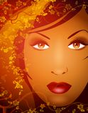 Beauty of Nature Female Face. An illustration featuring the face of a woman surrounded with decorative flowers in rich gold, red, and brown colours Stock Photos