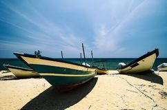 Fisherman boat on sandy beach under bright sunny day Stock Photography