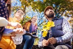 Nice pleasant children looking at autumn trees stock photography