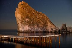Beauty of Night Diva. Night shot of starry dark blue sky, rock and sea. Crimea, Ukraine stock photography