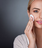 Beauty and nourished in middle age. Lovely woman cleaning her skin on the cheek stock photo