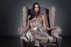Beauty in old armchair Stock Images