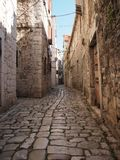 Beauty old narrow alley in UNESCO town, Trogir Royalty Free Stock Photo