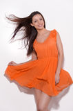 Beauty in orange dress. Stock Photography