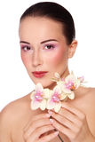 Beauty with orchid Stock Photography