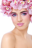 Beauty with orchids Stock Images
