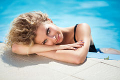 Beauty outdoor portrait of beautiful smiling woman resting in bl Stock Photo