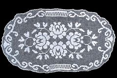 Beauty oval lace tablecloth isolated on black background, floral pattern. Cute out and texture for design. White pattern doily Stock Photos