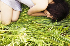 Beauty over the grass. Beautiful girl sleeping over the grass Stock Photography