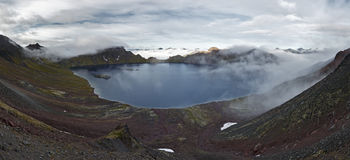 Beauty panorama: view of crater lake active Khangar Volcano on Kamchatka (Russia) Stock Photo