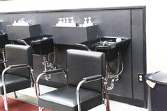 Beauty parlor. Hair dressers sink and chair Royalty Free Stock Images