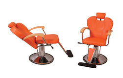 Beauty parlour chair - Orange Royalty Free Stock Images