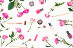 Beauty pattern with pink roses and cosmetics with accessories on white background. Woman`s day background. Flat lay, Top view. Beauty pattern with pink roses Royalty Free Stock Photos