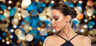 Beautiful young woman over party lights Royalty Free Stock Photo
