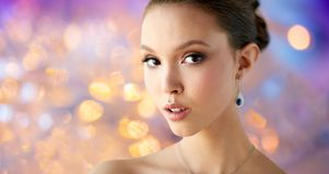 Close up of beautiful woman face with earring Stock Photo