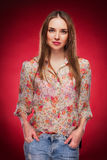 Beauty photo of an Caucasian model on red background.  royalty free stock image