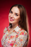 Beauty photo of an Caucasian model on red background.  stock photo