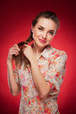Beauty photo of an Caucasian model on red background.  stock image