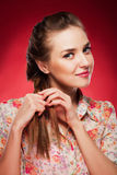 Beauty photo of an Caucasian model on red background.  royalty free stock images