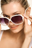 Beauty Picture of Girl wearing sunglasses. Girl wearing white sunglasses. peeking over the top of the glasses Royalty Free Stock Images