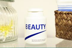 Beauty pills in a bottle on bathroom shelf Stock Photography