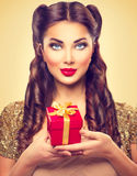 Beauty pin up girl with holiday gift box Stock Photo