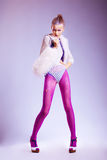 Beauty in pink erotic stockings white fur vest Stock Photo