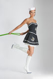 Beauty pinup girl in a sailor suit rope pulling Stock Images