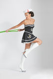 Beauty pinup girl in a sailor suit rope pulling Royalty Free Stock Image