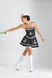 Beauty pinup girl in a sailor suit rope pulling Stock Photos