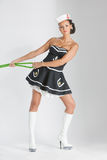 Beauty pinup girl in a sailor suit rope pulling Royalty Free Stock Photo