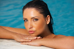Beauty in pool. Beautiful young woman in swimming pool royalty free stock photo