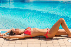 Beauty by the pool. Royalty Free Stock Images