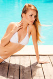 Beauty by the pool. Stock Photo