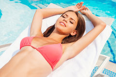 Beauty by the pool. Royalty Free Stock Photos
