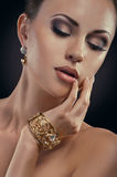 Beauty portait of young woman with golden bracelet. Beauty portait of young woman with jewelry Stock Image