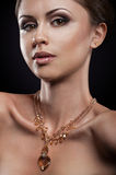 Beauty portait of young woman with necklace Royalty Free Stock Photography