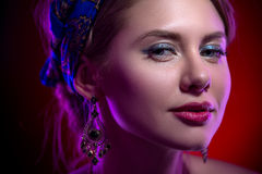 Beauty portert beautiful model in a bright scarf Royalty Free Stock Image