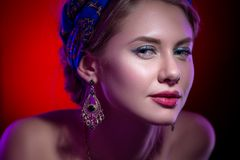 Beauty portert beautiful model in a bright scarf Stock Photography