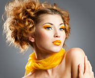 Beauty portrait. Beautiful woman with bright creative yellow makeup and curly hairstyle Royalty Free Stock Photography